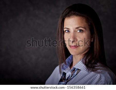 Beautiful female business person studio portrait - stock photo