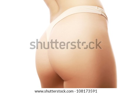 Beautiful female buttocks in beige panties - stock photo