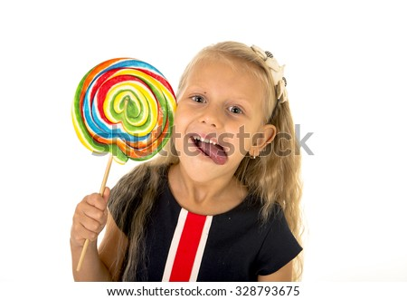 beautiful female child with long blond hair and blue eyes holding huge spiral lollipop candy smiling happy and excited eating and licking isolated on white background in sugar and sweet concept - stock photo