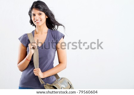 beautiful female college student with a shoulder bag - stock photo