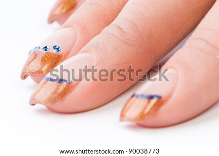 beautiful female colored fingernails isolated on white ground - stock photo