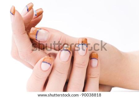 beautiful female colored fingernails isolated on white ground - stock photo