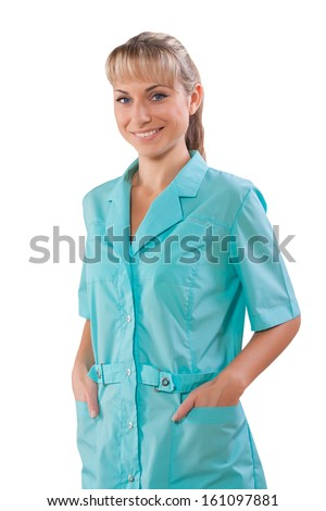 beautiful female doctor with hands in pockets isolated