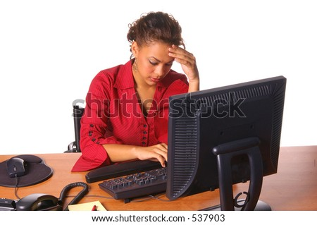 Beautiful female executive working on the computer - stock photo