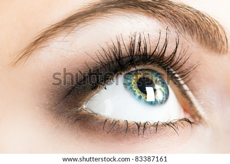 Beautiful female eye close up - stock photo