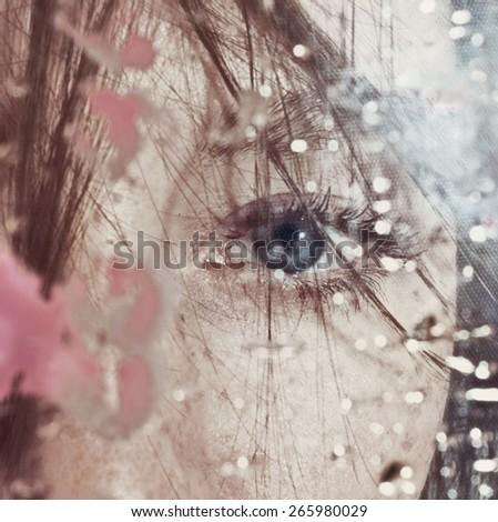 Beautiful female eye through the dirty glass closeup - stock photo