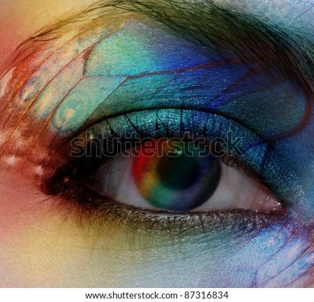 Beautiful female eye with make-up rainbow - stock photo