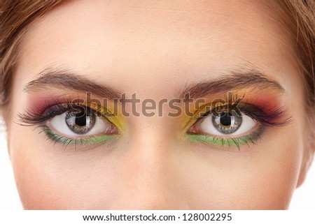 beautiful female eyes with bright autumn make-up - stock photo