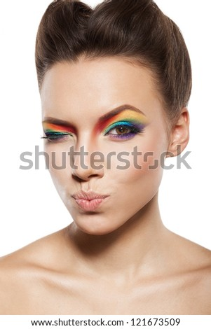 beautiful female face with rainbow makeup. girl is winking pursed lips - stock photo