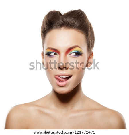 beautiful female face with rainbow makeup. girl winking and showing tongue - stock photo