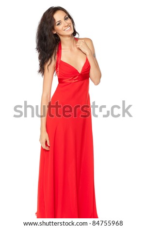 Beautiful female fashion model posing in red dress over white background - stock photo