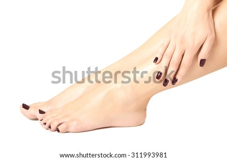 Beautiful female feet and hands with brown manicure isolated on white background