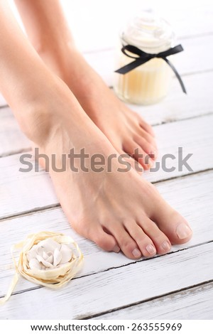 Beautiful female feet, smooth and neat.Beautiful feet of a woman during treatments. - stock photo