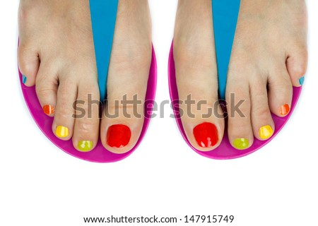 Beautiful female feet with a pedicure color. Isolated on white background - stock photo