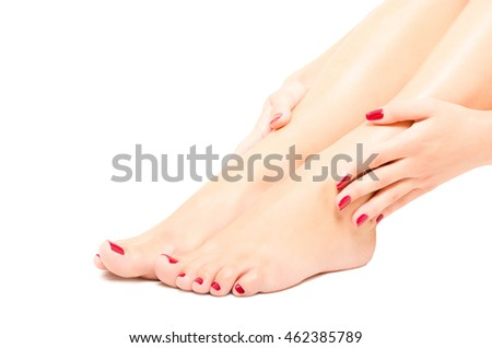 Beautiful female foot and hands with red manicure isolated on white background