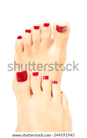 Beautiful  female foot with red pedicure on white background - stock photo
