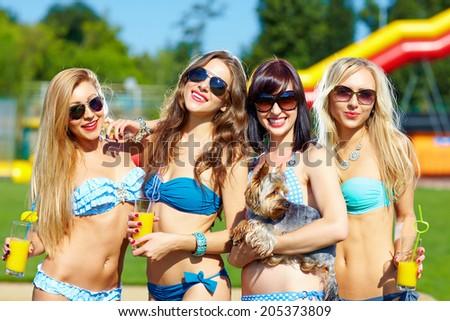 beautiful female friends having fun on summer vacation - stock photo