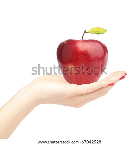 Beautiful female hand holding and showing a perfect red apple on white background - stock photo
