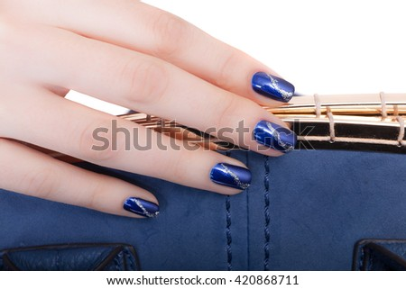 Beautiful female hand with green manicure close up. Isolated on white background  - stock photo