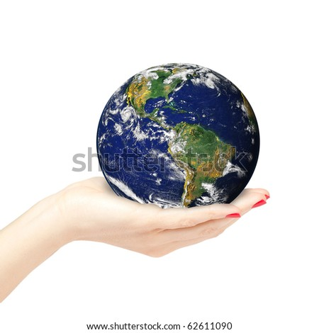 Beautiful female hand with red nails holding the Earth