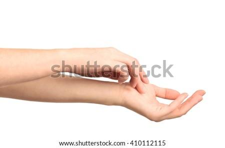 Beautiful female hands applying hand cream, isolated on white - stock photo