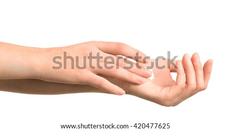 Beautiful female hands applying hand cream, isolated on white