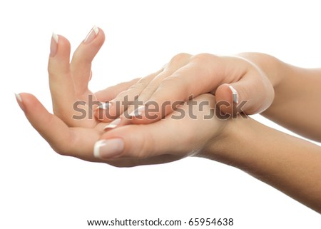 Beautiful female hands are isolated on a white background