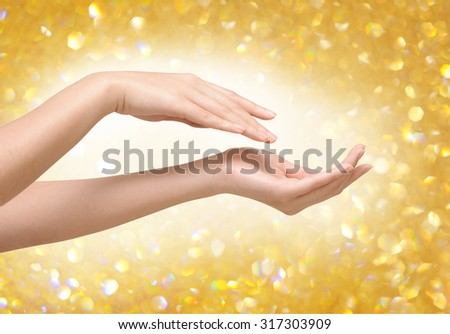 Beautiful female hands design with bokeh background  - stock photo