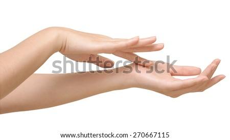 Beautiful female hands isolate, applying cream, massaging - stock photo