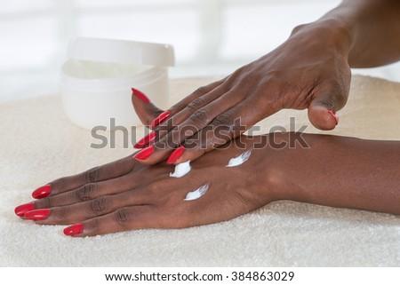 Beautiful Female Hands.Manicure concept-black beauty - stock photo