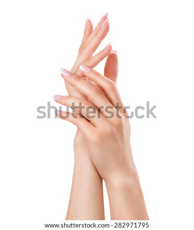 Beautiful Female Hands. Spa and Manicure concept. Woman hands with french manicure. Soft skin, skincare concept. Beauty nails. Isolated on white background - stock photo