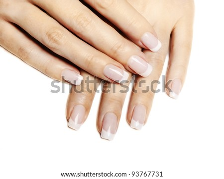 Beautiful female hands with french manicure isolated over white - stock photo