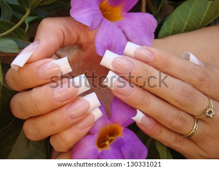 beautiful female hands with ideal sculptured french manicure - stock photo
