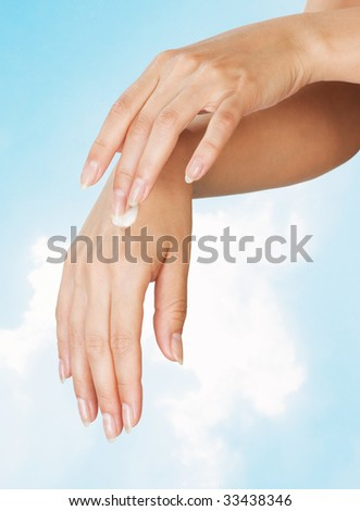 beautiful female hands with perfect manicure and smooth skin