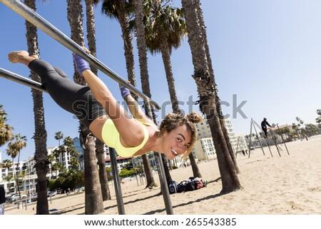 Beautiful female hanging upside down - stock photo