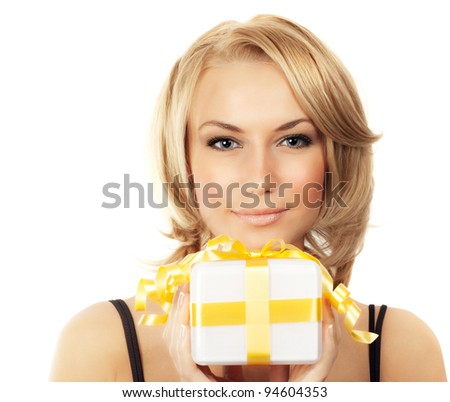Beautiful female holding gift, blond woman with present, pretty young girl holding golden box, portrait isolated on white background, celebrating holidays - stock photo