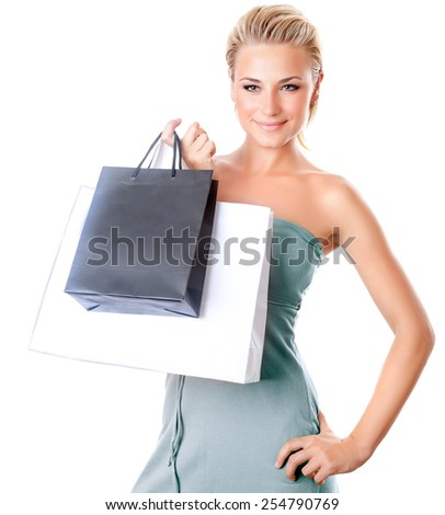 Beautiful female holding shopping bags, woman isolated on white background, girl buying presents and spending money, seasonal sales - stock photo
