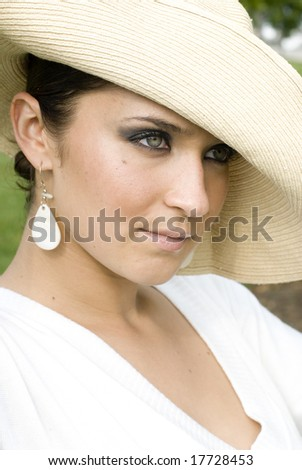 Beautiful female in a white dream and white hat - stock photo