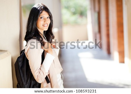 beautiful female indian college student portrait by corridor - stock photo
