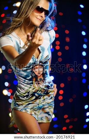 Beautiful female inviting to dance - stock photo