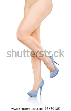 Beautiful female legs in high heels, isolated on white background - stock photo