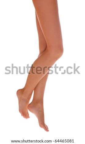 Beautiful female legs on white background. - stock photo