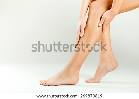 Beautiful female legs, smooth skin after waxing  - stock photo