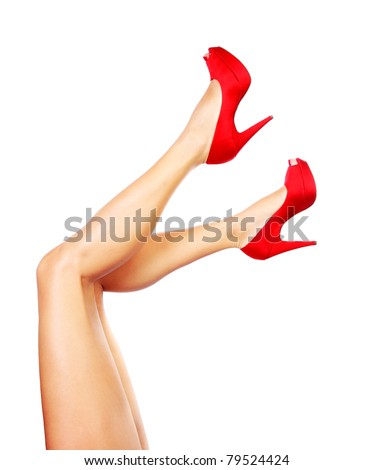 Beautiful female legs with red heels isolated on white background - stock photo