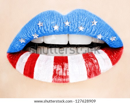 Beautiful female lips painted with American flag,macro photography - stock photo