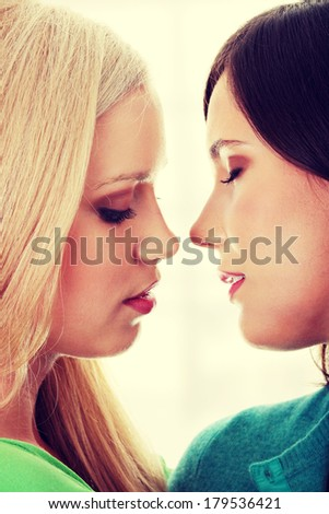 Beautiful female lovers kissing