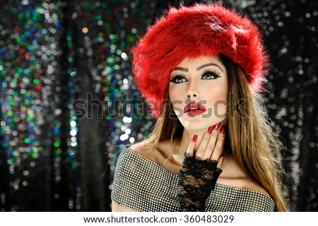 Beautiful female model in a hat with makeup and red lipstick - stock photo