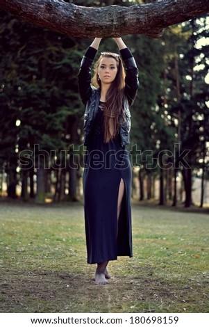 Beautiful female model in park - stock photo