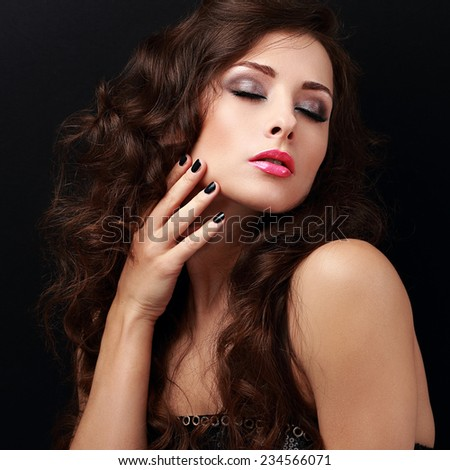 Beautiful female model touching hand health face skin. Closeup portrait on black background