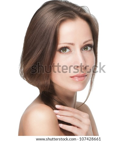 Beautiful female model touching her hair isolated on white background - stock photo